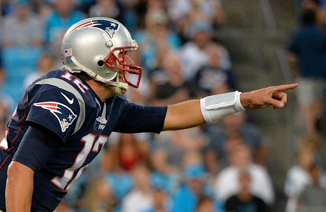 Tom Brady #12 of the New England Patriots reads the Carolina Panthers defense in the 1st quarter during their preseason NFL game at Bank of America Stadium on August 28, 2015 in Charlotte, North Carolina (AFP Photo/Grant Halverson)