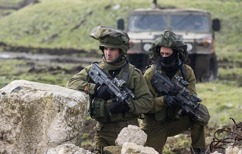 Israeli soldiers from the Golani Brigade take part in a military training exercise in the Israeli-annexed Golan Heights near the border with Syria, on January 19, 2015 (AFP Photo/Jack Guez)
