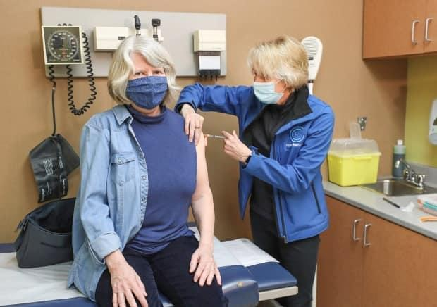 Cathy Faulkner, left, receives her COVID-19 vaccine shot from Dr. Linda Ferguson on Saturday at a walk-in clinic in Truro. (Communications Nova Scotia - image credit)