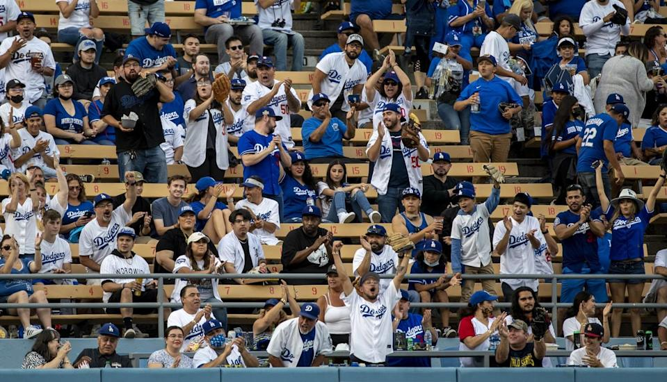 Dodger fans cheer the home team on reopening night at Dodger Stadium.