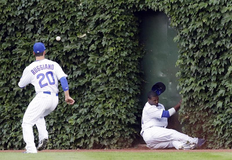 Chicago Cubs center fielder Junior Lake, right, can't make the catch on a double hit by Washington Nationals' Ryan Zimmerman as Chicago Cubs right fielder Justin Ruggiano chases the ball during the second inning of a baseball game in Chicago, Thursday, June 26, 2014. (AP Photo/Nam Y. Huh)
