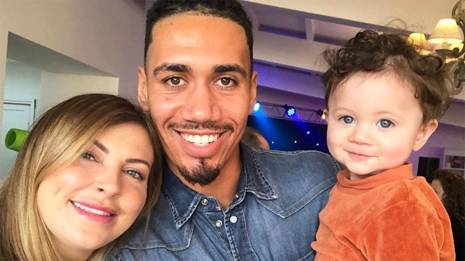 Seen here, Chris Smalling, his wife Sam Cooke and their two-year-old son Leo.