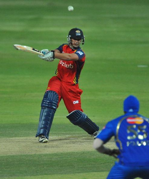 JOHANNESBURG, SOUTH AFRICA - OCTOBER 14:  Quinto de Kock of the Lions hits over the covers during the Karbonn Smart CLT20 match between Highveld Lions and Mumbai Indians at Bidvest Wanderers Stadium on October 14, 2012 in Johannesburg, South Africa.  (Photo by Duif du Toit/Gallo Images/Getty Images)