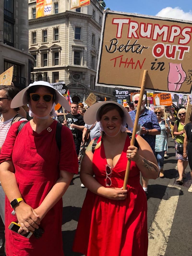 """The handmaid on the left, Angela Wardbrown, traveled from Winchester to attend today's protest. Totalitarian regimes, like the one on the hit show, """"have their roots in some of what Trump's doing now,"""" she said. """"It's endemic."""""""