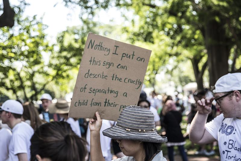 WASHINGTON, DC - JUNE 30: Protesters march against President Trump's immigration policy on June 30, 2018 in Washington, DC. As thousands of migrant children remain separated from family, rallies are planned across the U.S. calling for them be reunited with their families. (Photo by Alex Wroblewski/Getty Images)