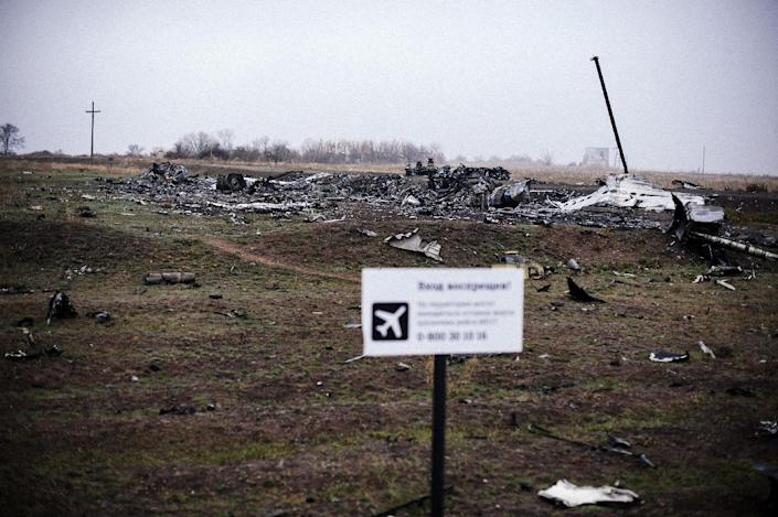 Parts of the Malaysia Airlines Flight MH17 lie at the crash site in the village of Hrabove, Ukraine, on November 7, 2014 (AFP Photo/Dimitar Dilkoff)