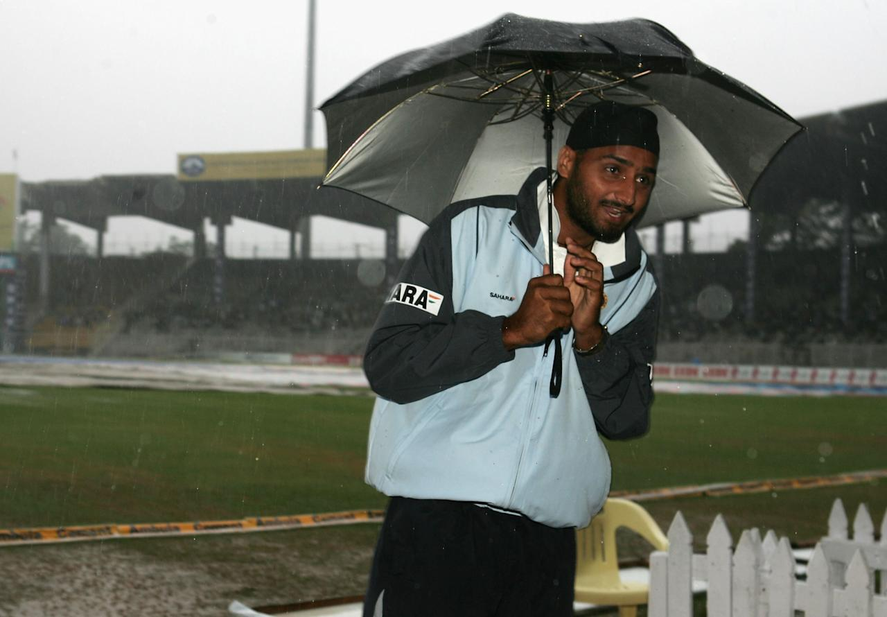 CHENNAI, INDIA - OCTOBER 18:  Harbhajan Singh of India stands in a rain soaked field as rain prevents play during day five of the Second Test between India and Australia played on October 18, 2004 at MA Chidambaram Stadium in Chennai, India.  (Photo by Hamish Blair/Getty Images)