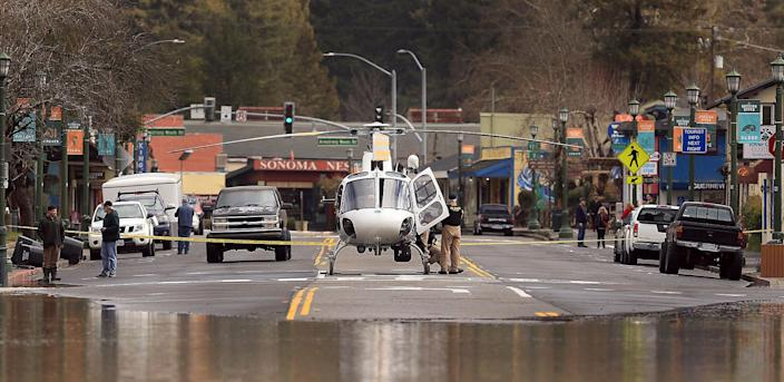 A CHP helicopter uses Main Street in Guerneville, Calif. as a landing pad as water continues to rise, Feb. 27, 2019. (Photo: Kent Porter/The Press Democrat via AP)