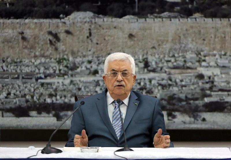 Palestinian president Mahmud Abbas chairs a meeting with members of the Palestinian leadership in the West Bank city of Ramallah, on August 16, 2014
