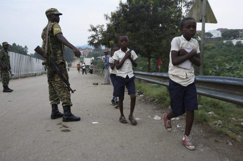 School going pupils from the Democratic Republic of Congo (DRC) are seen crossing the Mpondwe border point separating Uganda and the DRC on August 14, 2019. - Every day at dawn, Doneka Kabowo, a Congolese teenager, walks miles into the jungle, with the threat of armed militiamen who roam the area, to go to school across the border in Uganda. But for some time now, another obstacle has developed for the 15-year-old and hundreds of schoolchildren who daily travel from the Democratic Republic of Congo (DRC) to Uganda to study: health checks for prevent the transmission of the Ebola virus. (Photo by ISAAC KASAMANI / AFP) (Photo credit should read ISAAC KASAMANI/AFP/Getty Images)