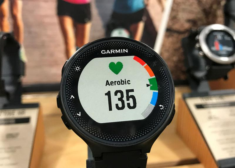 A Garmin GPS watch is shown on a display at a store in Encinitas