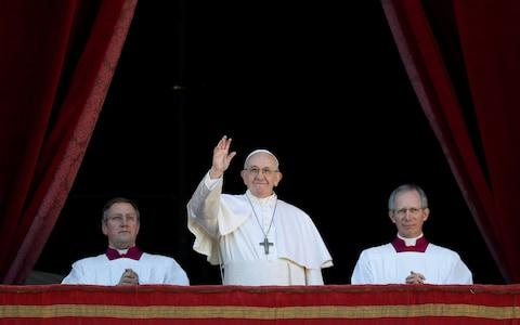 "Pope Francis waves after delivering the ""Urbi et Orbi"" message from the main balcony of Saint Peter's Basilica  - Credit: REUTERS/Max Rossi"