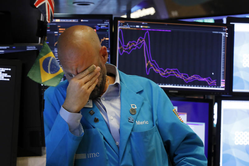 "Specialist Meric Greenbaum works on the floor of the New York Stock Exchange, Friday, Aug. 23, 2019. Stocks tumbled on Wall Street after President Donald Trump said he ""hereby ordered"" U.S. companies to consider alternatives to doing business in China. (AP Photo/Richard Drew)"
