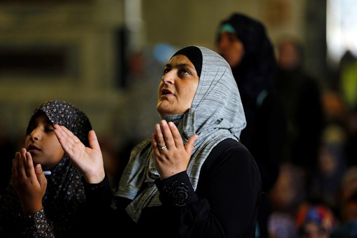 A Muslim woman prays during the Friday prayers for Ramadan, on the compound known to Muslims as Noble Sanctuary and to Jews as Temple Mount in Jerusalem's Old City June 16, 2017 . REUTERS/Ammar Awad