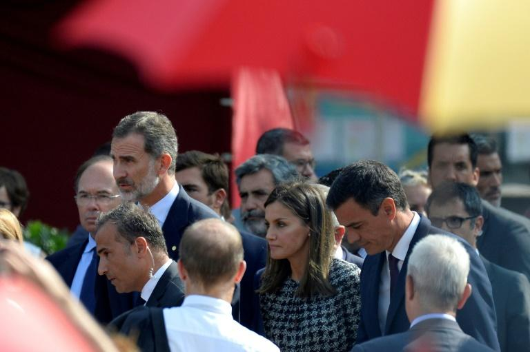 Spain's King Felipe VI (left), Queen Letizia and Prime Minister Pedro Sanchez led the memorial ceremony