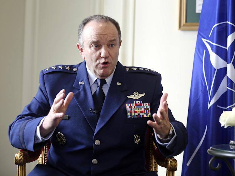 NATO Supreme Allied Commander Europe, U.S. Air Force General Philip Breedlove gestures during an interview with the Associated Press in Paris, Wednesday April 9, 2014, as he talks about his mission to formulate a plan to help protect and reassure NATO members nearest Russia. NATO's top military commander in Europe, Breedlove is tasked with drafting countermoves to the Russian military threat against Ukraine. (AP Photo/Remy de la Mauviniere)