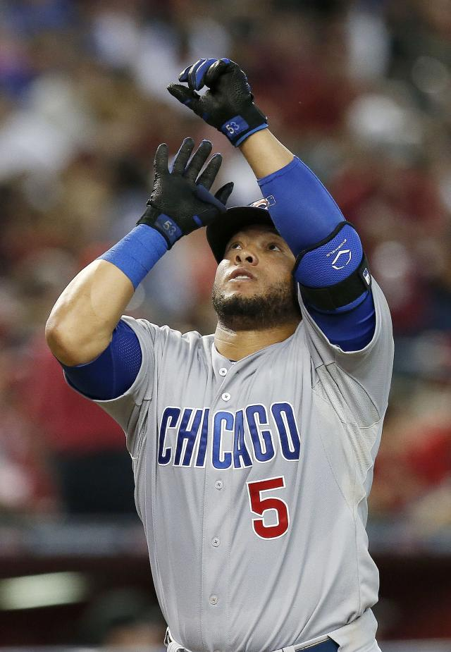 Chicago Cubs' Welington Castillo celebrates his home run against the Arizona Diamondbacks during the fourth inning of a baseball game on Saturday, July 19, 2014, in Phoenix. (AP Photo/Ross D. Franklin)