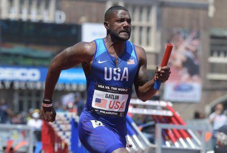 Apr 28, 2018; Philadelphia, PA, USA; Justin Gatlin runs the second leg on the USA Red 4 x 100m relay that won the USA vs. the World race in 38.39 during the 124th Penn Relays at Franklin Field. Mandatory Credit: Kirby Lee-USA TODAY Sports