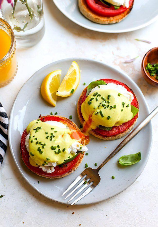"""<p>Heirloom tomatoes and fresh basil freshen up this classic breakfast dish. </p><p><strong>Get the recipe at <a href=""""https://www.twopeasandtheirpod.com/caprese-eggs-benedict/"""" rel=""""nofollow noopener"""" target=""""_blank"""" data-ylk=""""slk:Two Peas and Their Pod"""" class=""""link rapid-noclick-resp"""">Two Peas and Their Pod</a>.</strong></p>"""