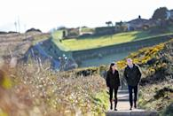 """<p>This gorgeous shot of Will and Kate enjoying a walk on a scenic cliff, taken during <a href=""""https://www.townandcountrymag.com/society/tradition/g31117301/prince-william-kate-middleton-ireland-visit-2020-photos/"""" rel=""""nofollow noopener"""" target=""""_blank"""" data-ylk=""""slk:their royal tour of Ireland"""" class=""""link rapid-noclick-resp"""">their royal tour of Ireland</a>, captures a rare moment of calm for the Cambridges.</p>"""