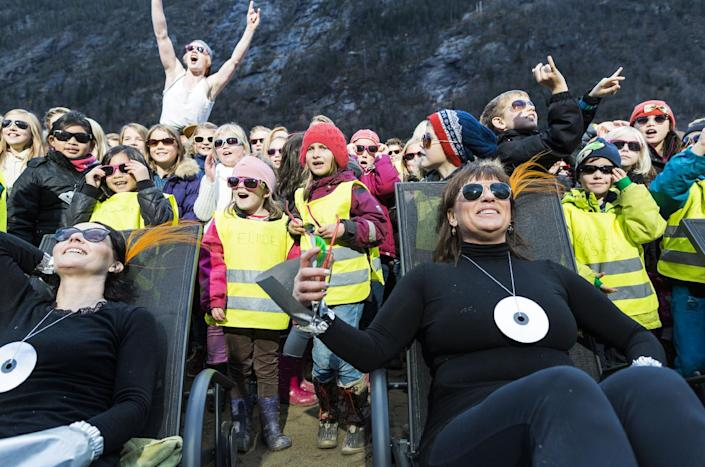 The inauguration on October 30, 2013 of sun mirrors (Solspeilet) set up on the hillside above Rjukan, Norway, to reflect sunlight down on the town square (AFP Photo/Krister Soerboe)