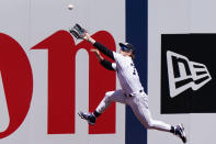 CORRECTS TO SECOND INNING, NOT FIRST - New York Yankees left fielder Clint Frazier (77) leaps for a double hit by Kansas City Royals' Hanser Alberto in the second inning of a baseball game, Thursday, June 24, 2021, at Yankee Stadium in New York. (AP Photo/Kathy Willens)