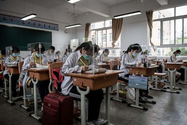 PHOTO: High school senior students study with plastic partitions in a classroom in Wuhan in China's central Hubei province on May 6, 2020. (AFP via Getty Images)