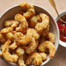 """<p>These air-fried popcorn shrimp get crispy and crunchy with very little oil. The unique flavors are inspired by Mexican fare, with a smoky, spicy dipping sauce and full-flavored shrimp coating. Look for the smallest shrimp you can find so they will cook evenly. <a href=""""http://www.eatingwell.com/recipe/270400/air-fryer-popcorn-shrimp/"""" rel=""""nofollow noopener"""" target=""""_blank"""" data-ylk=""""slk:View recipe"""" class=""""link rapid-noclick-resp""""> View recipe </a></p>"""