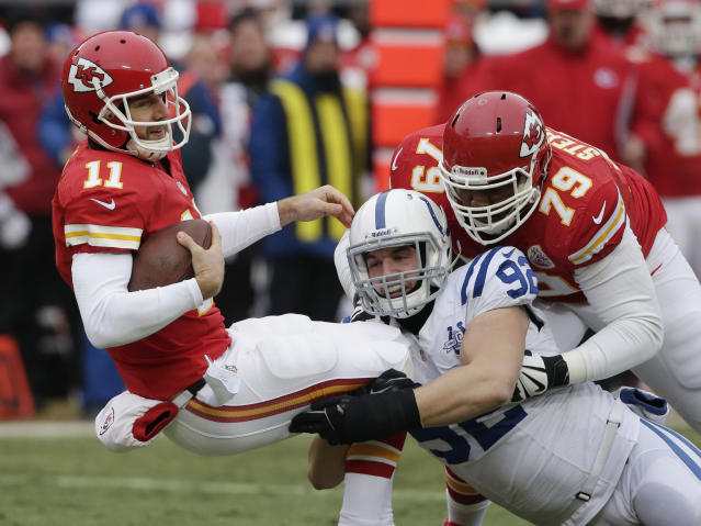 Kansas City Chiefs quarterback Alex Smith (11) is sacked by Indianapolis Colts outside linebacker Bjoern Werner (92) during the first half of an NFL football game at Arrowhead Stadium in Kansas City, Mo., Sunday, Dec. 22, 2013. Chiefs tackle Donald Stephenson (79) tries to block on the play. (AP Photo/Charlie Riedel)