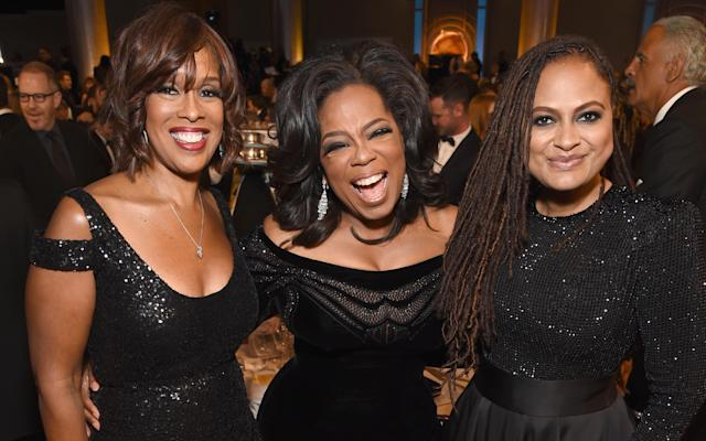 Gayle King, Oprah Winfrey and director Ava DuVernay pose for a photo at the Golden Globe Awards in Beverly Hills, Calif., on Sunday. (Michael Kovac/Getty Images for Moet & Chandon)
