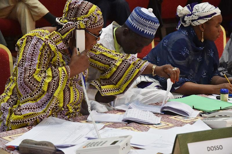 Niger's Commission electoral indenpendante (CENI) members check the results of the presidential election on February 22, 2016 at the palais des congres in Niamey, a day after the country's 1st round presidential and legislatives elections