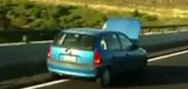 Man drives with hood up. Photo: YouTube