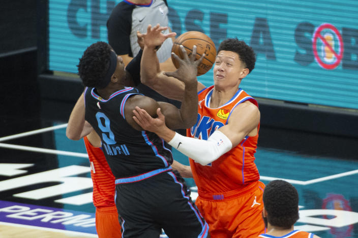 Sacramento Kings guard Terence Davis (9) is fouled by Oklahoma City Thunder center Isaiah Roby during the first quarter of an NBA basketball game in Sacramento, Calif., Tuesday, May 11, 2021. (AP Photo/Randall Benton)