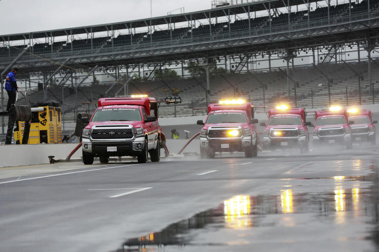 Track driers work to dry the pit lane before the NASCAR Brickyard 400 auto race at Indianapolis Motor Speedway, in Indianapolis Sunday, Sept. 9, 2018. (AP Photo)