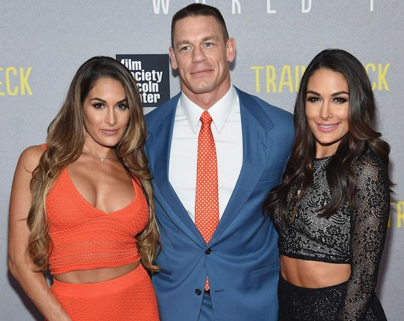 From left: Brie Bella, John Cena and Nikki Bella