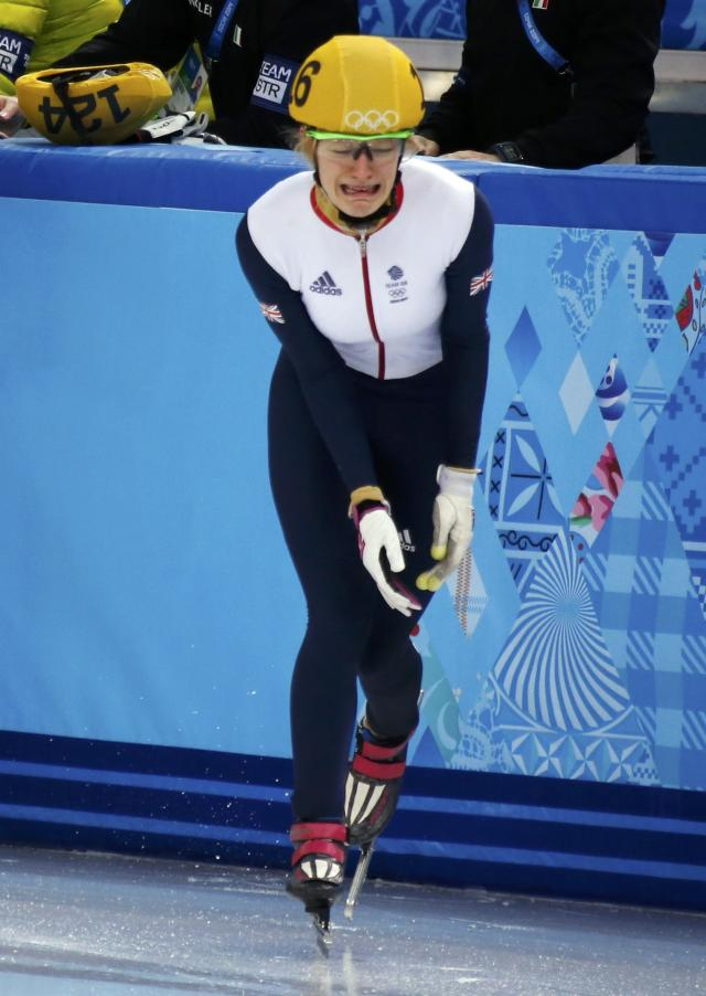 Britain's Christie cries after crashing out during the women's 500 metres short track speed skating final event at the Iceberg Skating Palace during the 2014 Sochi Winter Olympics