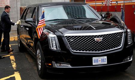 "Secret Service agent cleans U.S. President Donald Trump's new Cadillac limousine nicknamed ""The Beast"" before debut drive in New York City"