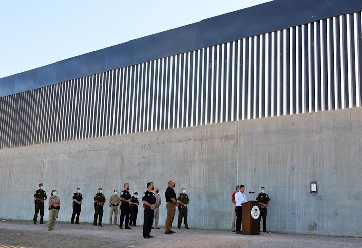 <p>Acting Homeland Secretary Chad Wolf gives a speech in front of a new section of the border wall on 29 October</p>The Monitor