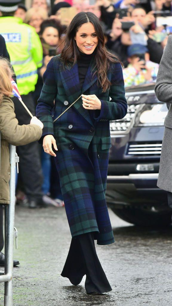 """<p>Megan Markle wore a navy and dark-green double-breasted tartan wool and <a href=""""https://www.net-a-porter.com/gb/en/product/992863/Burberry/double-breasted-tartan-wool-and-cashmere-blend-coat"""" rel=""""nofollow noopener"""" target=""""_blank"""" data-ylk=""""slk:cashmere-blend coat"""" class=""""link rapid-noclick-resp"""">cashmere-blend coat</a> from Burberry for her visit to Edinburgh this afternoon. She teamed her look with Veronica Beard trousers (which we presume to be the <a href=""""https://www.veronicabeard.com/Adley-Pants-2548.html?color=Black"""" rel=""""nofollow noopener"""" target=""""_blank"""" data-ylk=""""slk:Adley"""" class=""""link rapid-noclick-resp"""">Adley</a> pair). </p>"""