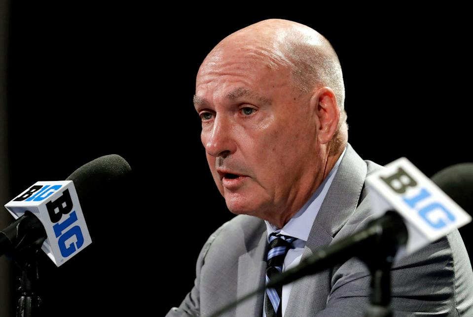 FILE - In this Oct. 11, 2018, file photo, Big Ten Commissioner Jim Delany speaks at a press conference during Big Ten NCAA college basketball media day, in Rosemont, Ill. Delany, one of the most influential figures in college athletics for three decades, will step down as Big Ten commissioner when his contract expires June 30, 2020. The Big Ten announced Delany's plans on Monday, March 4, 2019. The 71-year-old has been commissioner since 1989. (AP Photo/Nam Y. Huh, File)