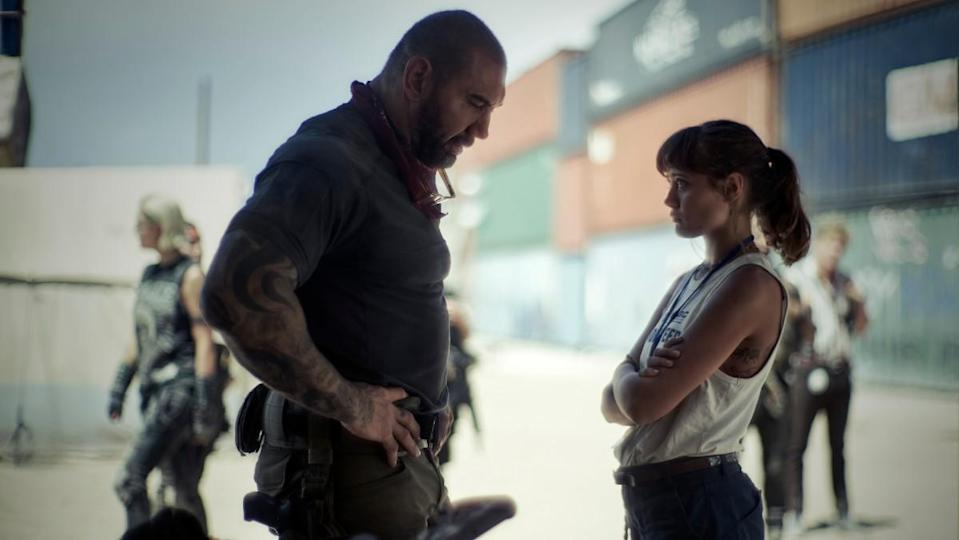 Dave Bautista stands over Ella Purnell is a scene from Army of the Dead.