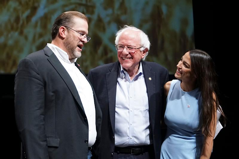 Kansas congressional candidate James Thompson with Sen. Bernie Sanders (I-Vt.) and Alexandria Ocasio-Cortez, a Democratic congressional candidate from New York, at a rally in Wichita, Kansas, on Friday. (Photo: Jaime Green/The Wichita Eagle via AP)