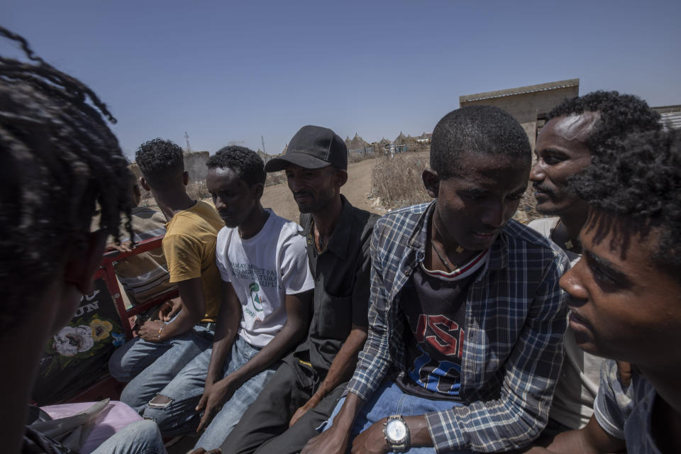 Tigrayan refugee Abraha Kinfe Gebremariam, 40, center, rides home after going to the market in Hamdayet, eastern Sudan, near the border with Ethiopia, on March 21, 2021. (AP Photo/Nariman El-Mofty)