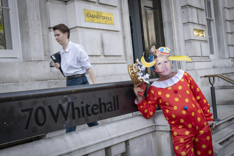 Anti-Brexit campaigner dressed as a clown impersonates Prime Minister Boris Johnson outside the Cabinet Office on Whitehall on the 29th August 2019 in London in the United Kingdom. A group gather outside the Cabinet Office, protesting against British Prime Minster Boris Johnsons announcement of a suspension of Parliament. (photo by Sam Mellish / In Pictures via Getty Images)