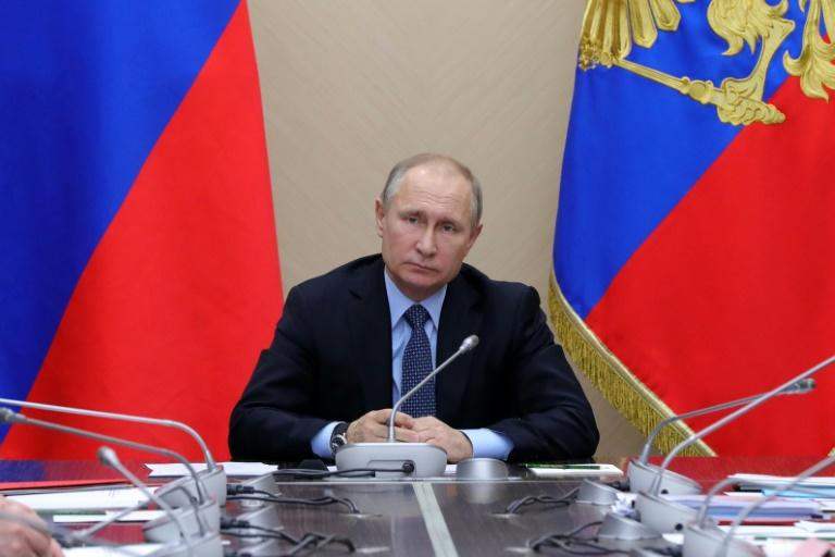 Navalny accuses Russian President Vladimir Putin, pictured here at a meeting in his country residence outside Moscow on January 16, 2018, of turning Russia into an authoritian state