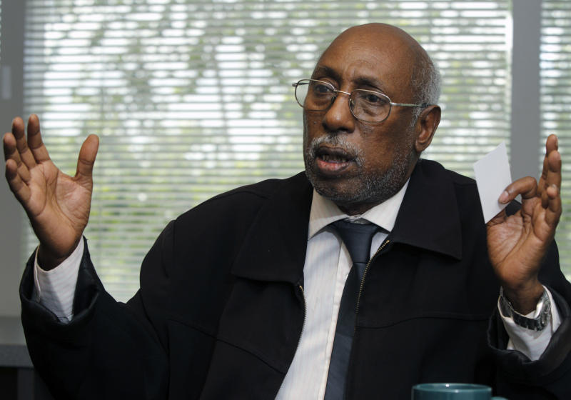 In this Friday, May 31, 2013 photo, Abukar Hassan Ahmed talks about the civil court case against former Somali Col. Abdi Aden Magan during an interview at The Associated Press bureau in Columbus, Ohio. Ahmed is seeking damages against Magan, who was found responsible last year for torturing Ahmed in the 1980s. (AP Photo/Paul Vernon)