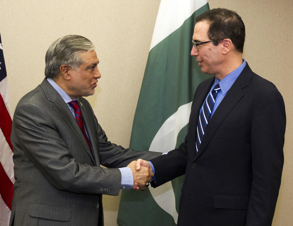 Treasury Secretary Steven Mnuchin, right, shake hands with Pakistan's Finance Minister Muhammad Ishaq Dar before a bilateral meeting during the World Bank/IMF Spring Meetings in Washington, Saturday, April 22, 2017. ( AP Photo/Jose Luis Magana)