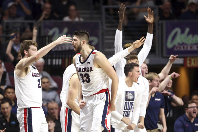 Gonzaga's Killian Tillie (33) celebrates after sinking a three-point basket against San Francisco during the second half of an NCAA college basketball game in the West Coast Conference men's tournament Monday, March 9, 2020, in Las Vegas. (AP Photo/Isaac Brekken)