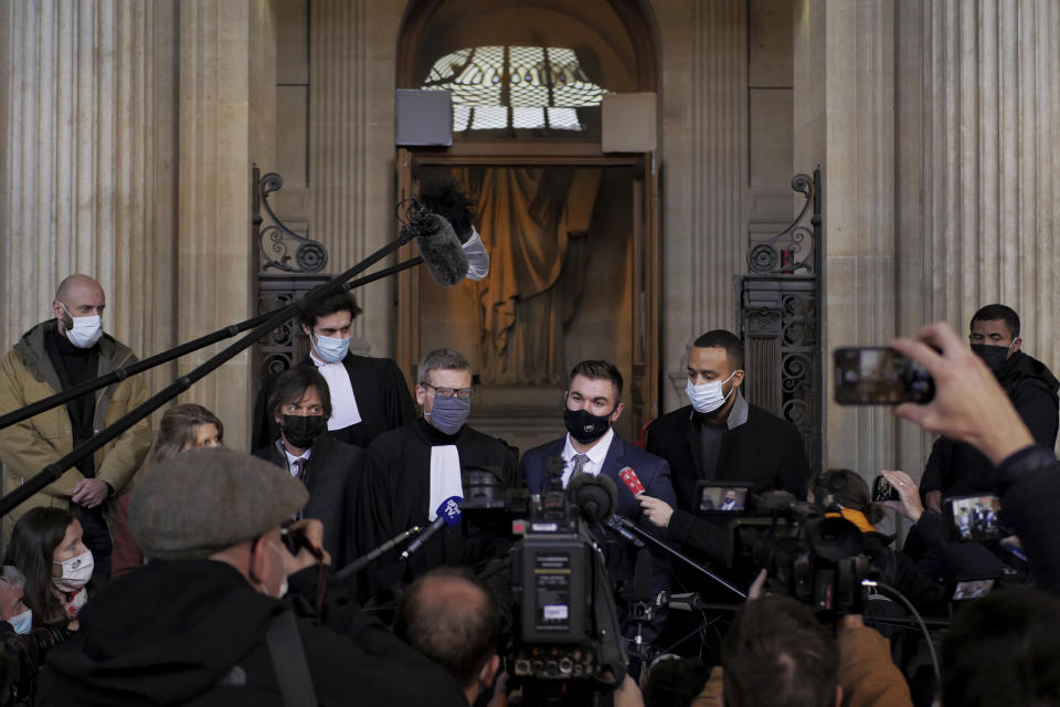 Alek Skarlatos, center right, Anthony Sadler, right, Mark Moogalian, left, and their lawyer Thibault de Montbrial, center left, deliver a speech during the Thalys attack trial at the Paris courthouse, Friday, Nov. 20, 2020. Passengers who wrestled and disarmed an Islamic State gunman aboard a high-speed Amsterdam to Paris train are recounting how their split-second decisions helped prevent what could have become a mass slaughter. AP Photo/Thibault Camus)