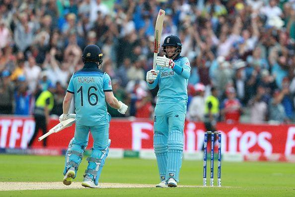 Joe Root and Eoin Morgan celebrate a job well done on Thursday.